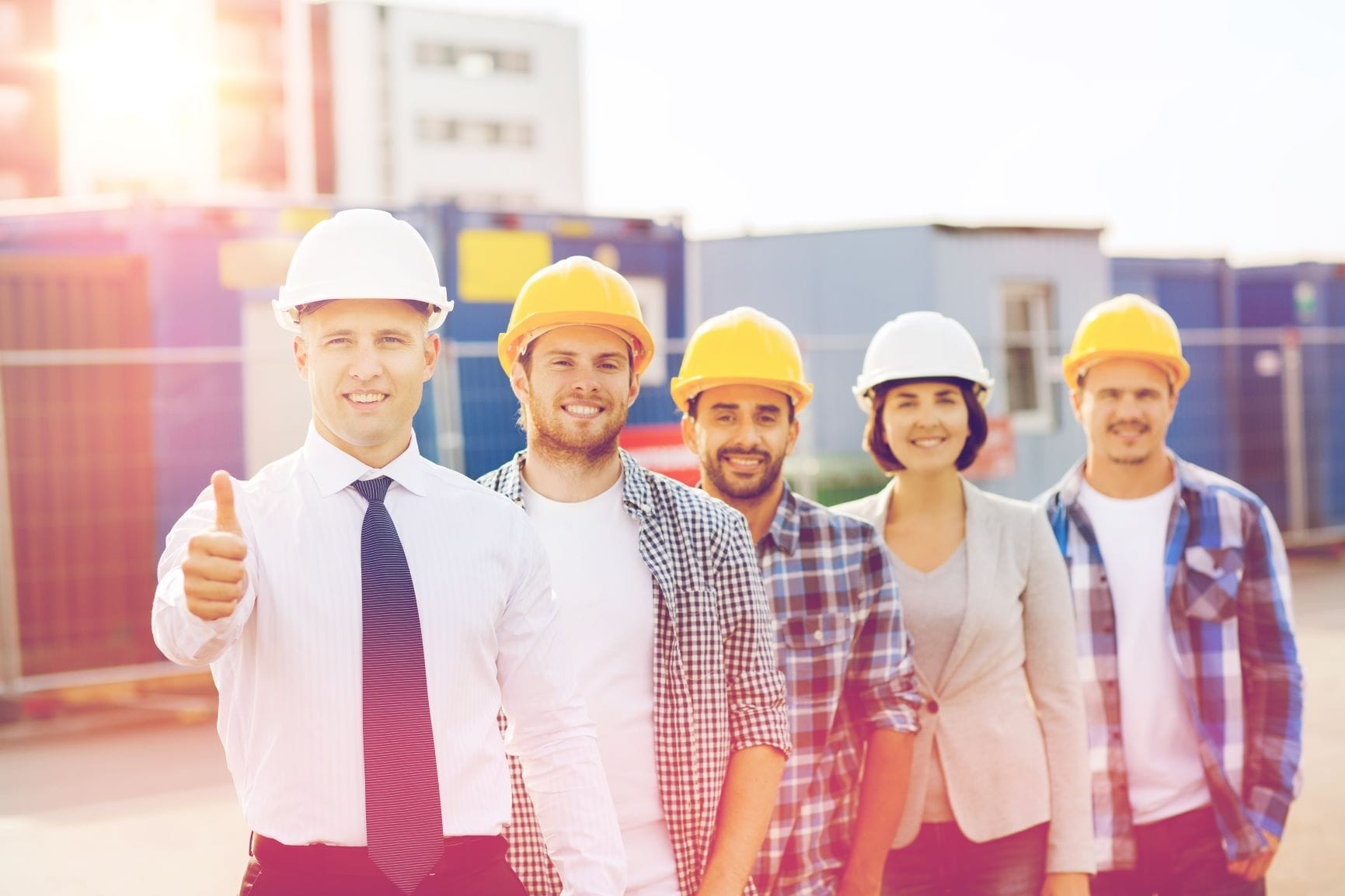 image of five happy construction workers